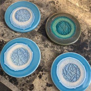 Four Anthropologie ceramic coasters
